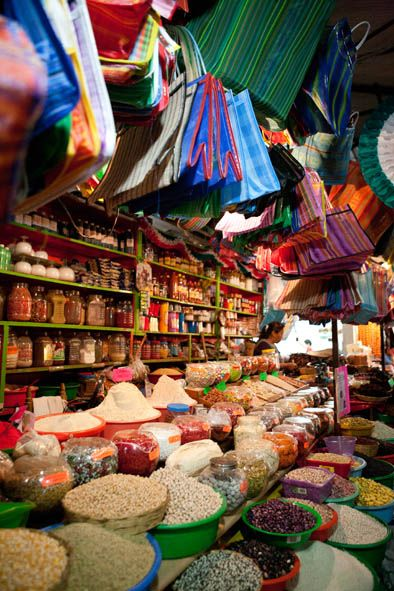 Amazing image of a market in Oaxaca. The displays and colors are so beautiful. Amazing that they have been that way for years.
