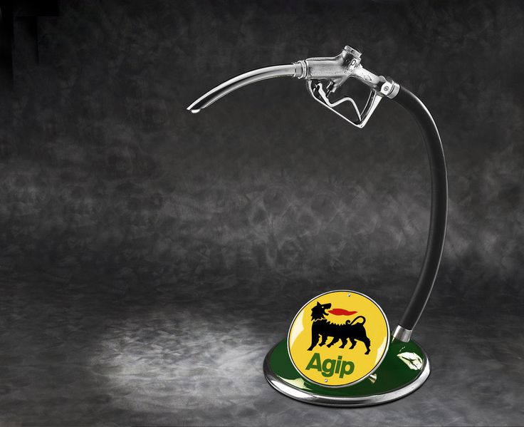 Hand crafted in Italy by an internationally renowned artist, this original fully restored fuel dispenser lamp makes the perfect collector's piece or gift!