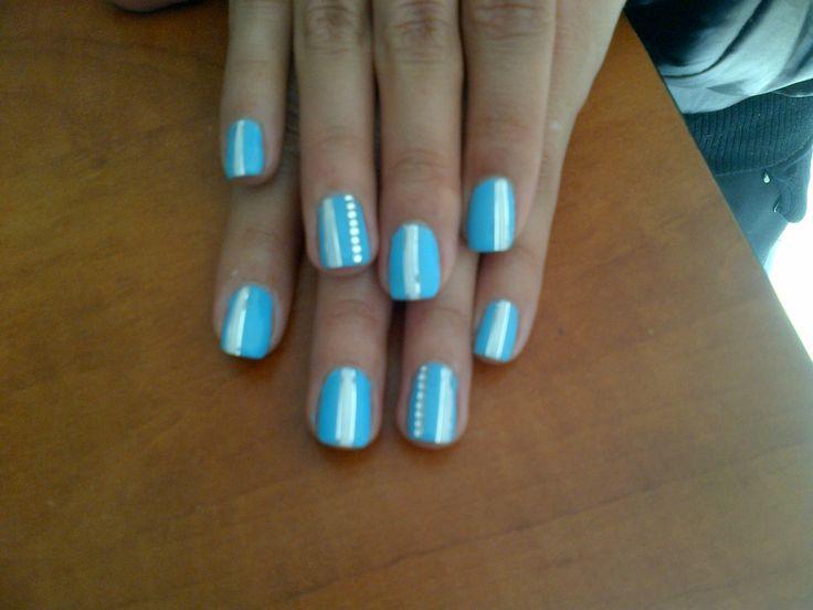 Pastel blue striped nails