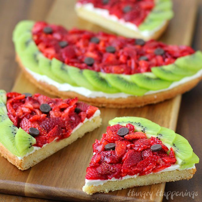 A fun summer treat with a twist. This Strawberry Kiwi Fruit Pizza with it's sugar cookie crust looks like a watermelon but tastes like a dessert.