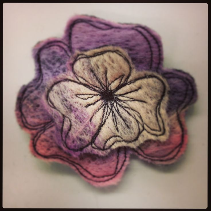 Machine felted and free motion embroidered flower. Using Janome felting machine and sewing machine.