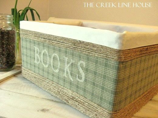 DIY storage bin made from a cardboard box with twine to give it a baskety look.