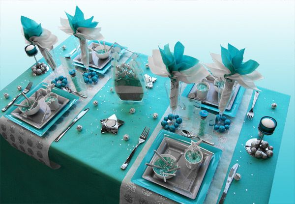 Christmas table decoration in turquoise, silver and white