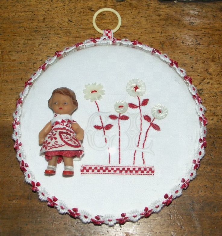 Doll and accessories framed