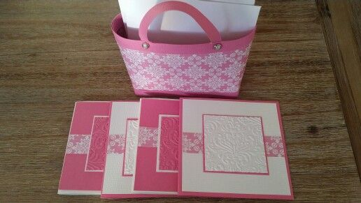 Pink and white handbag and note cards.