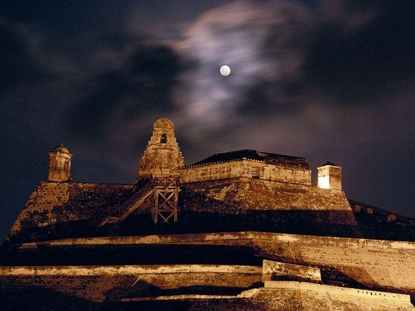 The moon rises over the fortress of San Felipe de Barajas in Cartagena.