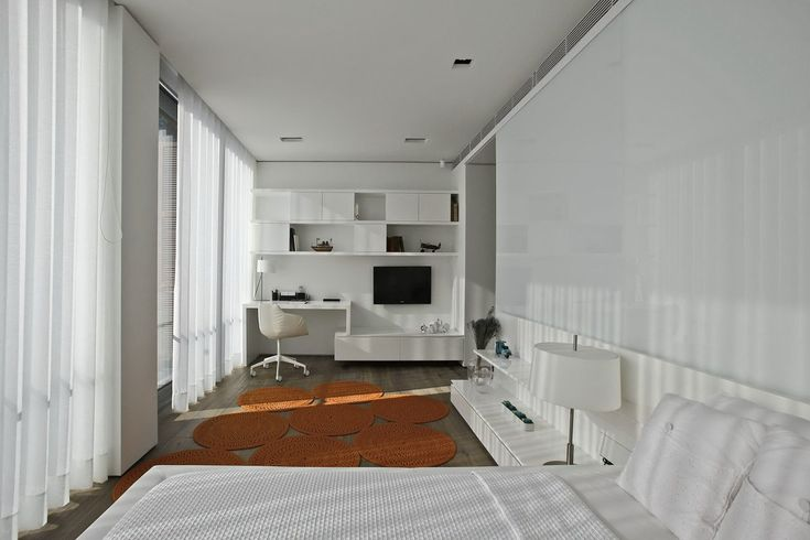 """Istanbul-based studio Tanju Özelgin has designed the interior of the S House. This 4,300 square foot, three story, contemporary house designed by Emre Arolat Architects is located in Istanbul, Turkey.                          S House Interior by Tanju Özelgin """"Çubuklu Valley is a private residential development located in a forested area of the district of Beykoz in the northern Bosphorus area of Istanbul. This development features a group of modern homes designed by Istanbul practice Emre…"""