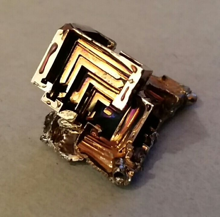 230.00  B012 Bismuth Crystal Pyramid on cluster base2.5x2x2cm16grams075889090 healingoilproducts@gmail.comPlease note that photos do not do justice to the beauty of Bismuth and actual crystal colours may vary.