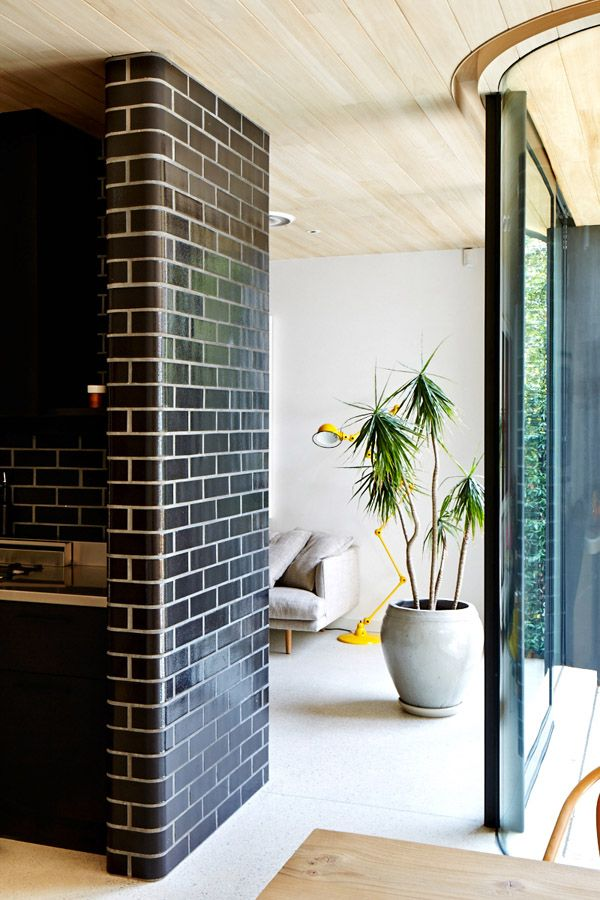 Curved Black Brick Wall |  Photo - Sean Fennessy, production – Lucy Feagins / The Design Files.