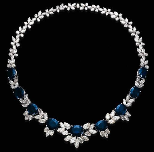 Sapphire and diamond necklace. The front is desig…