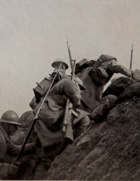 WWI, 1916, France. French soldiers over the top.
