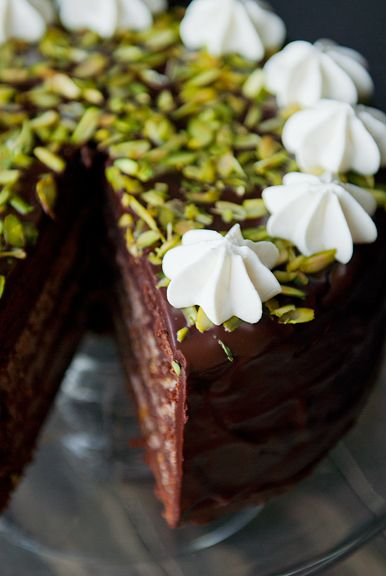 Chocolate Cassata Cake - chocolate cake with a chocolate, orange, and pistachio ricotta filling, soaked in Grand Marnier simple syrup, and glazed in chocolate ganache.