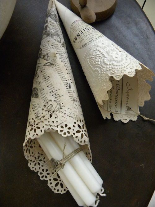 Find a lace hole punch and apply to old sheet music or scrapbook paper. Roll into a cone and use to serve treats, rice/seeds to throw at a wedding or whatever.