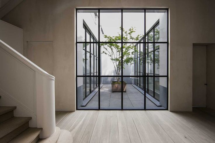 Staircase with small courtyard by Vincent van Duysen.