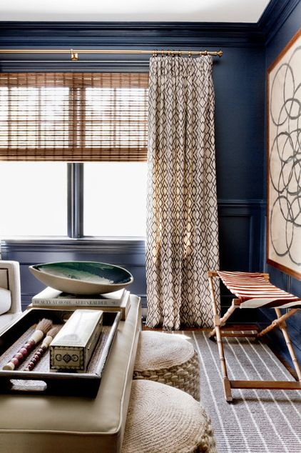 fabric for the window treatments. Because her clients were not afraid to go with dark paint, she pulled an indigo hue straight from the fabric to use on the walls. The owners had added extensive millwork throughout the house