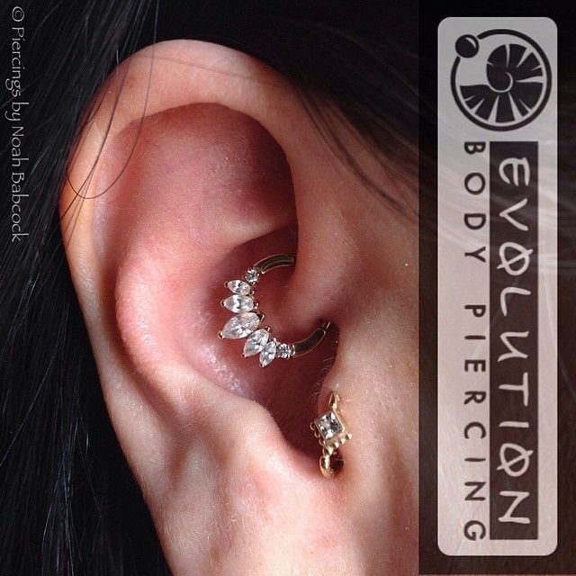 Daith piercing with rose gold and CZ. Tragus piercing with yellow gold and CZ jewelry by BVLA (at Evolution Body Piercing)