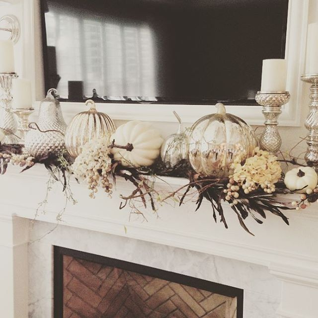 Real pumpkins mix with metallic HomeGoods pumpkins for elegant effect on this mantle.