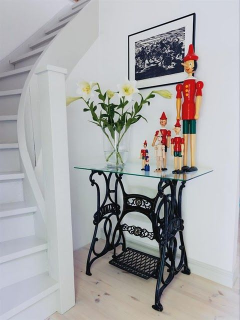 A restored vintage sewing table makes a fabulous addition to your entrance