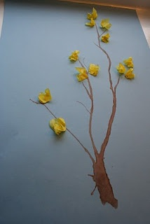 Straw blown twig with tissue paper flowers. Simple but cute from Pink and Green Mama blog