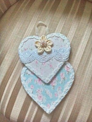 A bespoke double heart wallhanging.