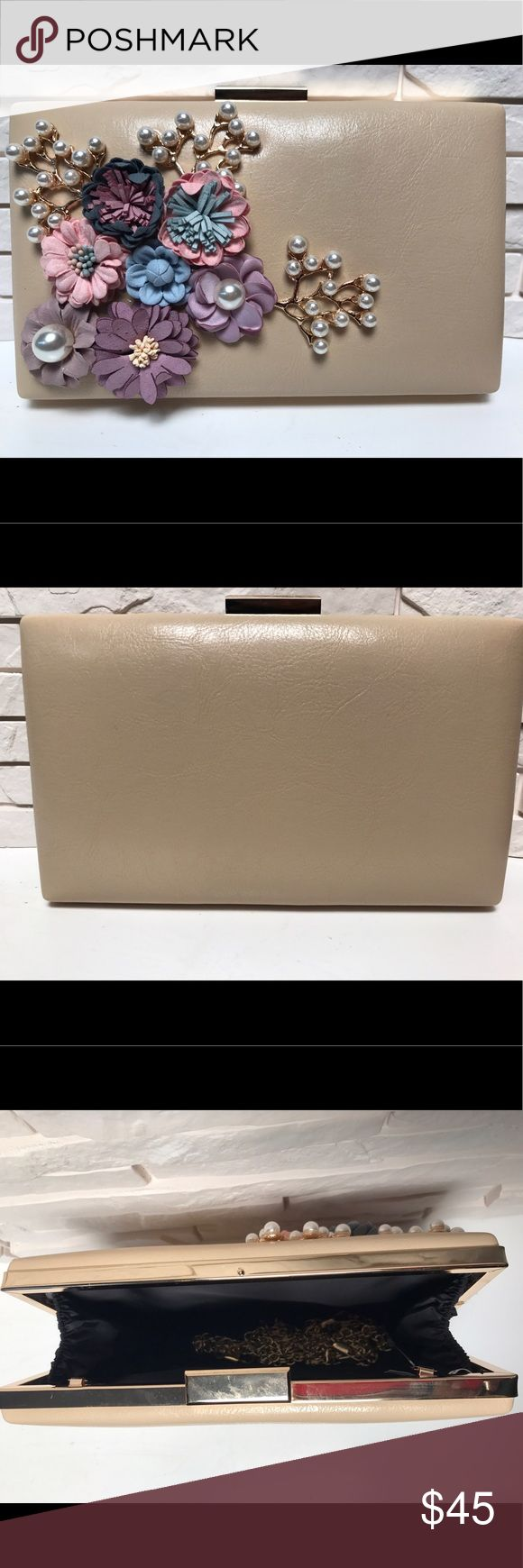 """Fleur Clutch (Taupe/Beige) Beautiful snap Clutch with gold hardware. Off-white is perfect for your summer outfits. Adorned with flowers as pearls. Measures H: 5"""" / L: 8"""" / W: 2"""" Bags Clutches & Wristlets"""