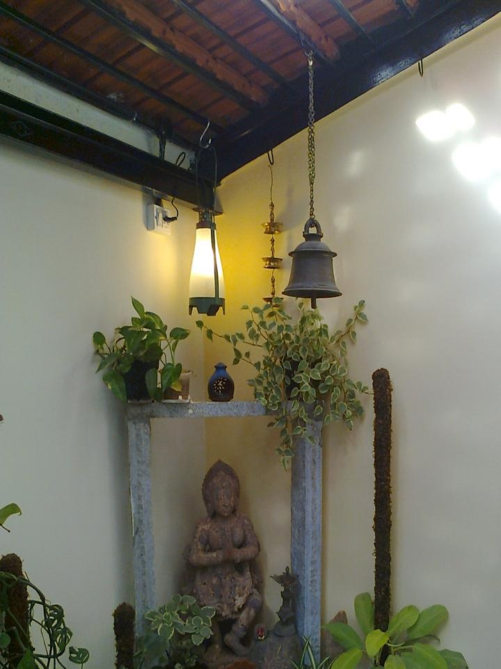 Bells and antique statue add a great appeal to the outdoors. #OutdoorInspirations