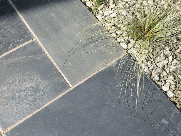 Slate ----Stylish and modern, slate is a hardwearing fine-grained stone whose color darkens beautifully when wet. Unless polished, it's nonslip, even when wet, making it ideal for pathways. Various surface textures are available, including rough cut, sandblasted and polished; all benefit from sealing