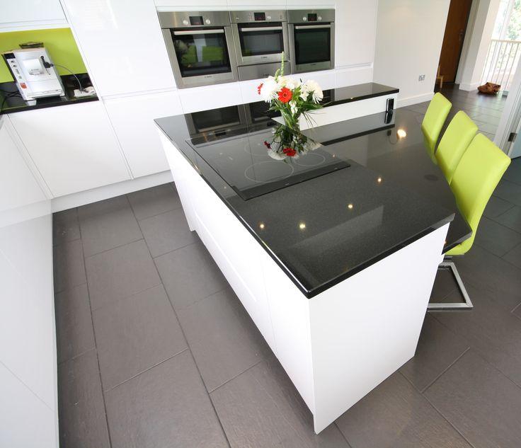 Travail Kitchen: Remo White Gloss Units, Black Granite