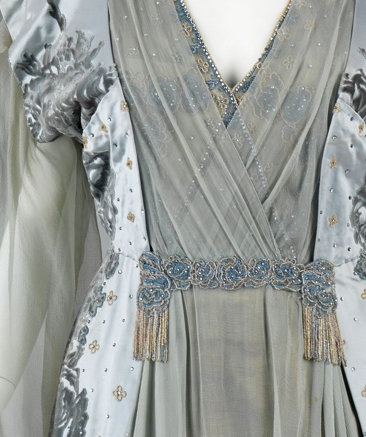 fashioninhistory:  Tea Gown (Detail) House of Worth  1910 This was worn by the wife of one of the great American bankers of the 19th century, J.P. Morgan, Jr. (1867-1943). It exemplifies the grandeur of Worth clothing among wealthy Americans, who aspired to be associated with European royalty.