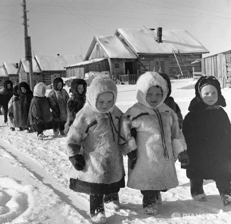 Children walking along a village street in the Arkhangelsk Region, northern Russia. 1967.