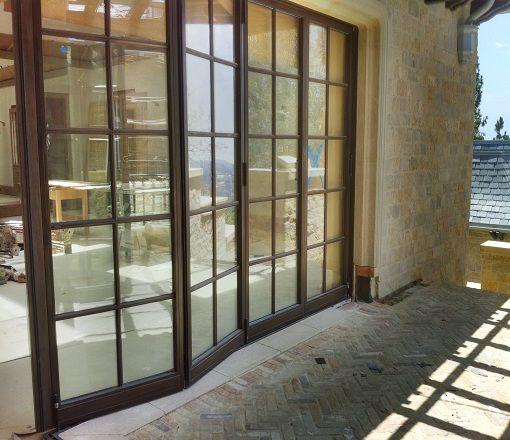 Flex Bi-Fold Cold Rolled Steel Doors, Bronze Doors, and Stainless Steel Doors   Optimum Window Mfg- notice trim around outside of door- set-in on wall