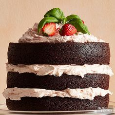 This beautiful layered cake has a brownie-like texture and delicious, creamy strawberry buttercream frosting. A great make-ahead recipe for chocolate lovers, this dessert works well for birthdays, celebrations, or a fancy after-dinner treat. Top with fresh strawberries for a finishing touch!