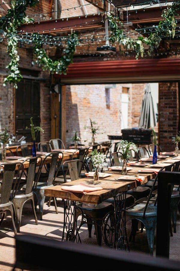 Wooden tables, brick walls, lots of greenery   Andrew Franciosa Studio