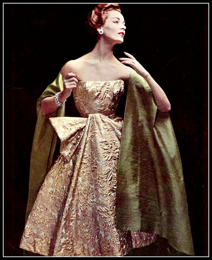 Model in sumptuous gold brocade cocktail dress worn with silk shantung cape-stole by Jacques Heim, jewelry by Roger Scémama, photo by Philippe Pottier, 1956