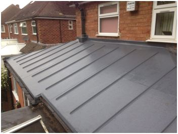 Sarnafil roof on Kitchen extension. Lead Grey Standing seams to create zinc look roof. 15 Guarantee provided from both us and Sika, along with 10 year insurance backed guarantee post installation