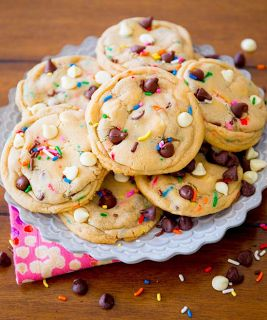 Cake Batter Chocolate Chip Cookies Recipe: 1 and 1/4 cup all-purpose flour, 1 and 1/4 cup yellow or white boxed cake mix, 1/2 tsp baking soda, 3/4 cup unsalted butter, softened to room temp, 1/2 cup granulated sugar, 1/2 cup light brown sugar, 1 egg, at room temp, 1.5 tsp vanilla, 1 cup chocolate chips (pinner used blend of white and semi-sweet chocolate chips), 1/2 cup sprinkles