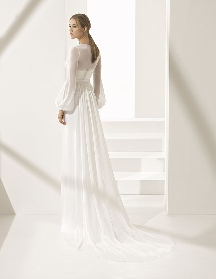 d9c94bfe Classic elegance combines with contemporary bridal styling in this sheath  dress with chiffon jacket with long