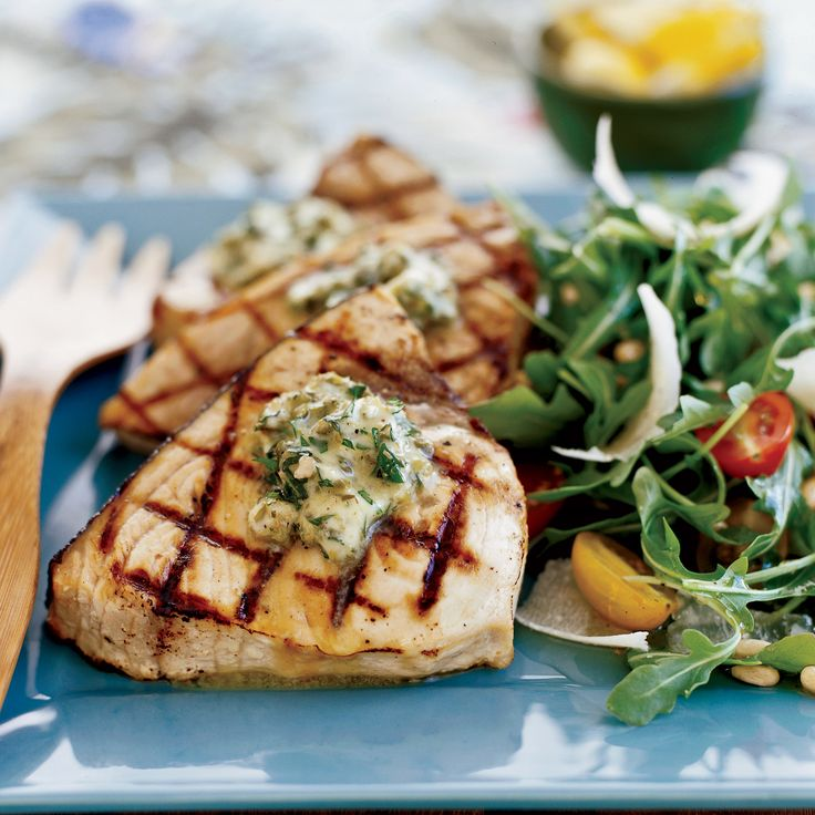 Grilled Swordfish Steaks with Basil-Caper Butter - These easy swordfish steaks are smothered with a delicious basil-caper butter and can be ready in under 45 minutes.  http://www.foodandwine.com/recipes/grilled-swordfish-steaks-basil-caper-butter
