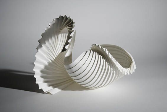 Looking like a set of architecture models for a Gaudi building, Richard Sweeney's paper sculptures are organic, poetic, intricate, and mostly made without the aid of glue or tape. Taking his inspiration from the shapes and forms that occur in nature - like clouds, mounds of snow, he fold