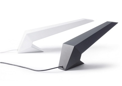 Coma Lamp  date: 2007  type: table lamp  material: aluminium, sheet metal  size: 630 x 240 x 150mm  The self-supporting metal enclosure is made all in one piece.