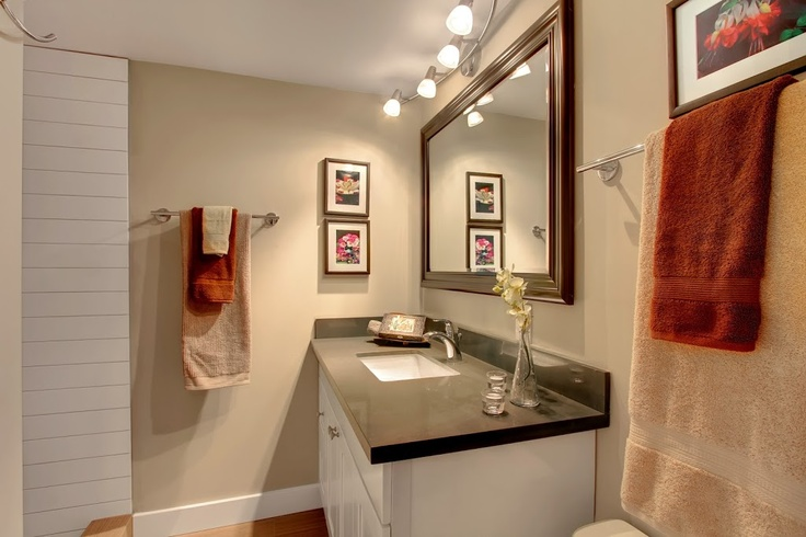 Heaton Dainard flips another house in Greenwood Seattle.. charming bathroom with black countertops, white subway tile and other fantastic details..