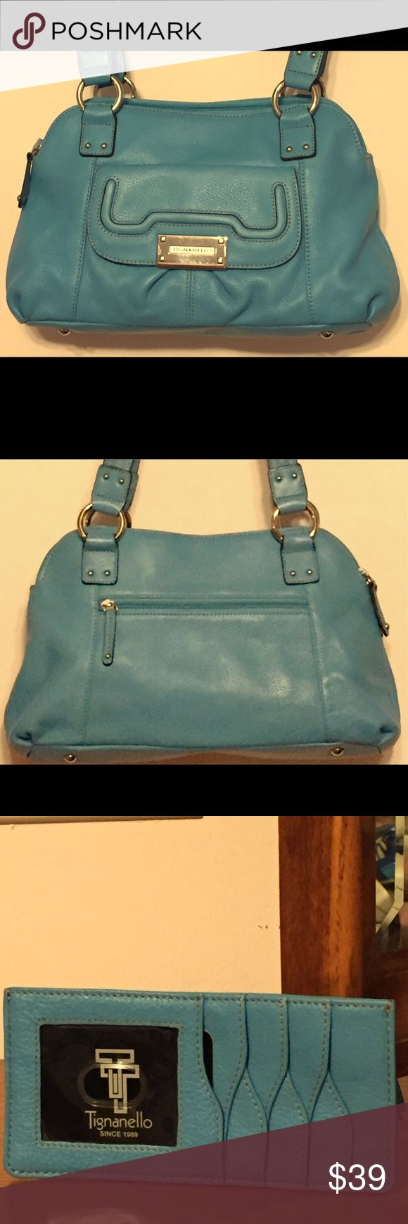 "Tignanello Leather Satchel Beautiful turquoise double zip top pebble leather Tignanello satchel & matching slim wallet. Purse has good sized pocket with magnetic closure on front & rear zipped pocket.  2 large zip compartments with one having 2 slip & 1 zip pockets. Front buckle has a few minor hard to see scratches. Barely noticeable unless you look for it. Otherwise, bag in mint condition. Measures 14""L x 8""H x 4 1/2""W & 11"" strap drop. Wallet measures 6 3/4""L x 3 1/4""H. See pictures for…"