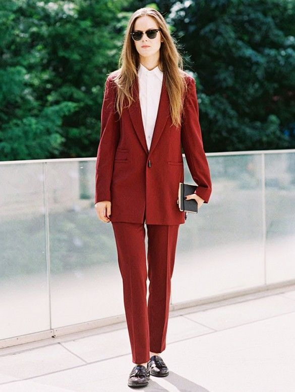 A burgundy suit is paired with patent oxfords