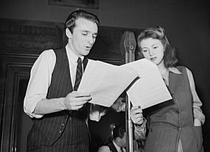 Rehearsal for the World War II radio show You Can't Do Business with Hitler with John Flynn and Virginia Moore. This series of programs, broadcast at least once weekly by more than 790 radio stations in America, was written and produced by the radio section of the Office of War Information (OWI).