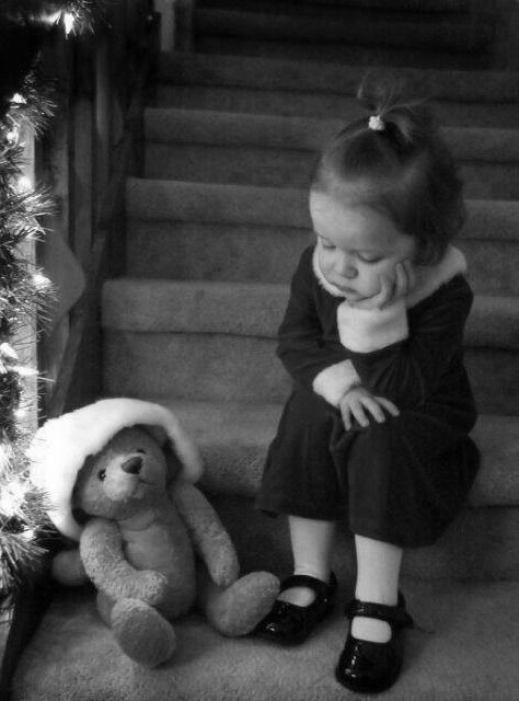"❥I think she is pondering something. Maybe the meaning of Christmas or 'is that all I got was a Teddy Bear?"" Love this photo. So many things she could be thinking."