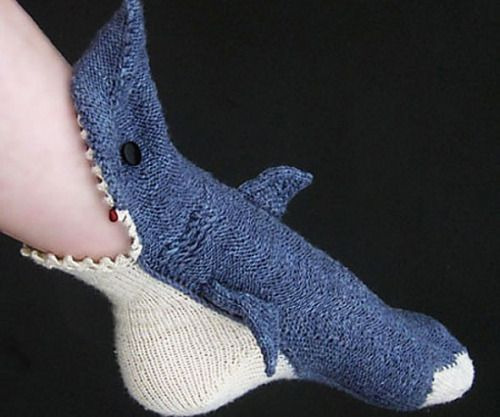 Shark Socks  Whod ever thought having your foot chomped on by a great white could feel so good? Once this handmade shark sock latches its yarn teeth around you and envelops your feet in its cozy innards youll never want him to let go.  $38.00  Check It Out  Awesome Sht You Can Buy