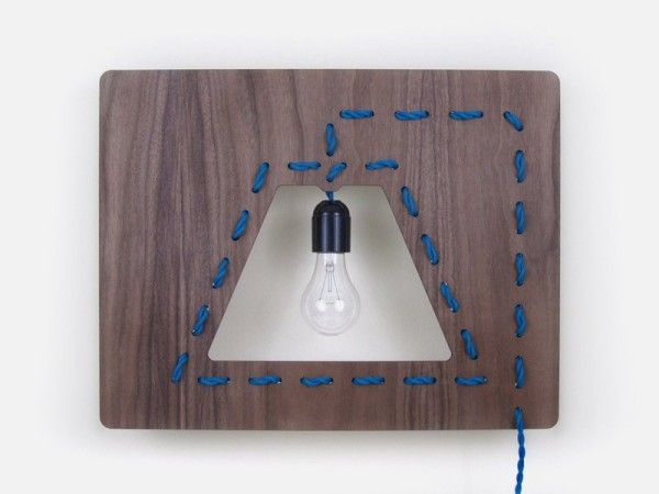 Wall Mount Lighting With Stitched Cord On Walnut Board Stitched