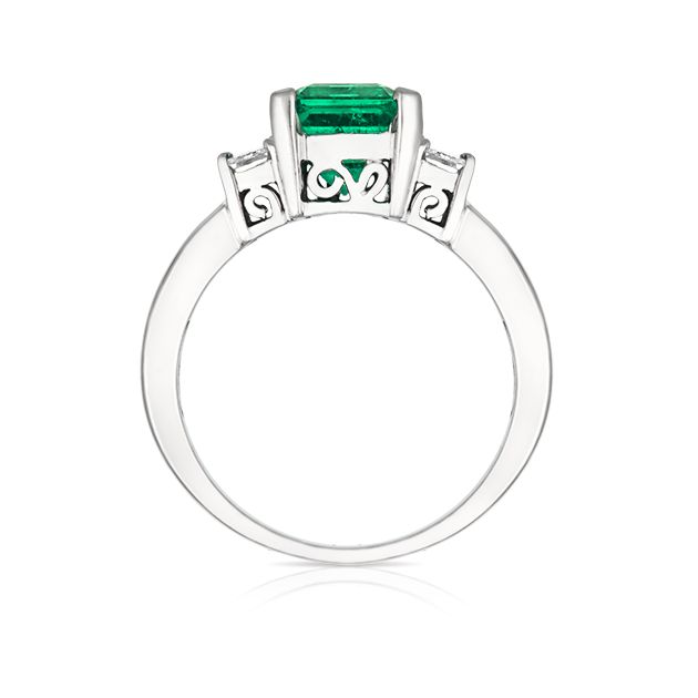 Crafted in 18 carat white gold, this timeless Natural Emerald and Diamond ring is truly spectacular and needs to be seen to truly appreciate it's beauty.
