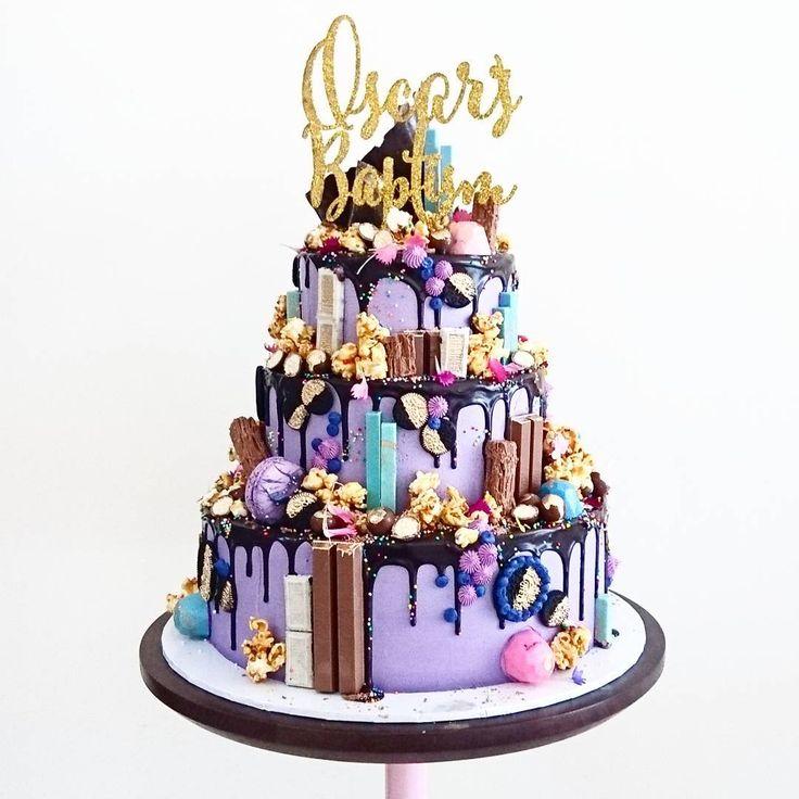 3 Tier Hero for Oscar's Baptism. Cake topper by @communicakeit