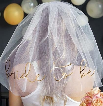 This stunning white veil is perfect for the Bride to wear to her Bachelorette Party! The veil says 'BRIDE TO BE' in gold foil for a classy, fun look!